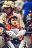 MEKONG DELTA - JUNE 14: Unidentified kid on a motorbike with his Stock Images