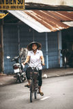 MEKONG DELTA - JUNE 14: An unidentified middle aged woman riding Stock Photos