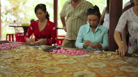 MEKONG DELTA,VIETNAM - MAY 2014: Coconut candy makers stock footage