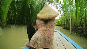 MEKONG DELTA,VIETNAM - 14 MAY 2014: Rower Paddle Canoe stock video footage