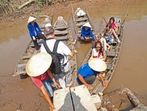 Mekong River Boat ride. Tourist getting onto small boats to start a sightseeing boat ride along Mekong River. Ideal for writeup of Mekong River, Vietnam Stock Photos