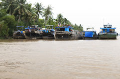 Mekong River boats. Picture of homes of landless Vietnamese living in boats stock photo