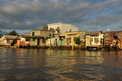 Mekong river delta. Riverfront houses and shacks Royalty Free Stock Images