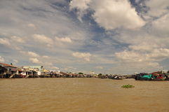 Mekong river delta. Riverfront houses and shacks Stock Photos