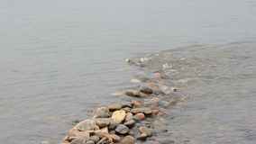 Mekong river flow through stones stock footage