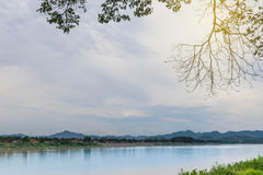 Mekong River between Lao PDR and Chiang Khan district, Loei prov. Ince, the beautiful sky, cloud, and the branches of trees with the beam light ,lens flare Stock Image