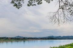 Mekong River between Lao PDR and Chiang Khan district, Loei province, the beautiful sky, cloud, and the branches of trees. Mekong River between Lao PDR and Stock Images