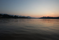 Mekong river at Luang Prabang, with mountain range. Sunset view of Mekong river at Luang Prabang, Laos, UNESCO World Heritage town, with mountain range in Stock Image
