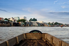 Mekong river trip. A boat heads  towards the village of Can Tho, where is held the daily market on the river Mekong, one of Vietnam's most interesting tourist Stock Photos