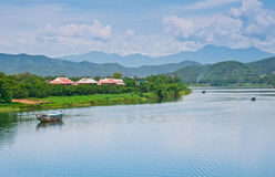 The Mekong River, Vietnam. The Mekong River of Vietnam, with mountains in the background Royalty Free Stock Photos