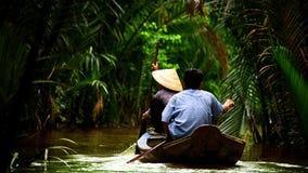 Mekong. Vietnamese people sailing on the Mekong river Stock Images