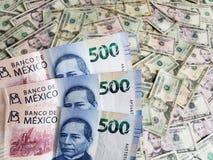 Meksykańscy banknoty i Amerykańscy dolary rachunków fotografia stock