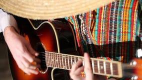 Meksykanin bawić się gitary zakończenia plan, Bawić się gitarę zbiory
