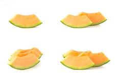 Melão, partes cortadas no fundo branco Imagem de Stock Royalty Free