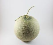 Melón verde aislado en el fondo blanco Imagenes de archivo