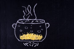 Mel drawn pan in which cooked cereal. Black background Stock Images