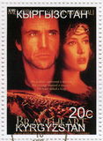 Mel Gibson and Sophie Marceau. Stamp printed in Kyrgyzstan with Mel Gibson and Sophie Marceau in The Braveheart film poster, circa 2000 royalty free stock photography