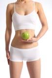 Mela bianca della holding della biancheria intima del torso femminile sano Fotografia Stock Libera da Diritti