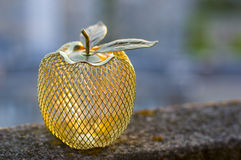 Mela dorata del metallo Fotografia Stock