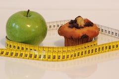 mela e muffin Fotografia Stock Libera da Diritti