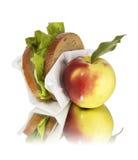 mela e panino della refezione Fotografia Stock