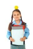 Mela felice della holding della scolara sulla testa Fotografia Stock