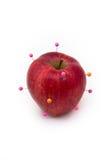 Mela isolata rossa con i perni Immagine Stock Libera da Diritti