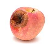 mela marcia con un grande foro su bianco immagine stock