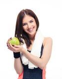 Mela sorridente della tenuta della donna di forma fisica Fotografia Stock Libera da Diritti