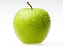 Mela verde bagnata Immagine Stock