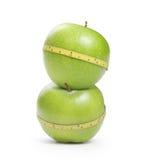 Mela verde con la misura Immagine Stock Libera da Diritti