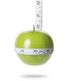Mela verde con la misura Immagini Stock Libere da Diritti