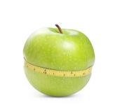 Mela verde con la misura Fotografia Stock