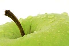 Mela verde con le goccioline Fotografie Stock Libere da Diritti