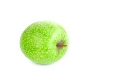 Mela verde isolata macchiata su una priorità bassa bianca Fotografia Stock Libera da Diritti