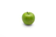 Mela verde su priorità bassa bianca fotografie stock libere da diritti