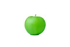 Mela verde su priorità bassa bianca Fotografia Stock