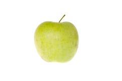Mela verde su un primo piano bianco del fondo fotografie stock libere da diritti