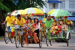 Melaka, Malaisie : Taxis célèbres de fleur Photo stock