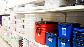 Plastic storage box. MELAKA, MALAYSIA - April 13, 2018 : Assorted brand of plastic storage box on shelf rack display in the Tesco store Stock Image