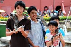 Melaka, Malaysia: Kids with Snake Stock Photos