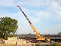 Crane lift a concrete block. MELAKA, MALAYSIA, Mac 29, 2018 : Crane lift a concrete block from trailer to construction site. Bridge construction at Lebuh Sungai Stock Photos