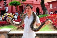 Melaka, Malaysia: Man with Snake Royalty Free Stock Photography