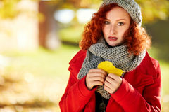 Melancholic ginger girl in autumn Stock Image