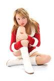 Melancholic girl dressed as Santa Royalty Free Stock Photos