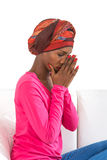 Melancholic and sad  woman wearing a headscarf. Beautiful African woman wearing a headscarf Stock Photos