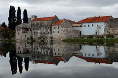 Melancholic scene with Houses reflected on river in Bosnia and Herzegovina Royalty Free Stock Image