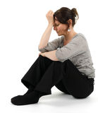 A melancholic woman. Is sitting on the floor Stock Photo