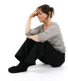 A melancholic woman. Is sitting on the floor Stock Photography