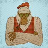 Melancholic Yeti with Smoking Pipe, Tartan Waistcoat and Hat. Stock Image